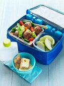 Meatballs, fruit and crackers for a picnic