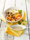 Pork in a honey and mustard sauce with carrots and rice