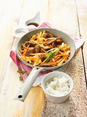 Roast duck with pineapple, carrots and a side of rice