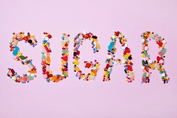 Colourful sweets spelling out the word SUGAR