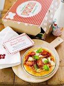 Ham, basil and mozzarella pizza