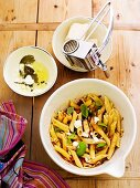 Penne pasta with goat's cheese and herbs