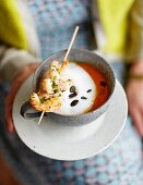 Pumpkin cappuccino with a prawn skewer