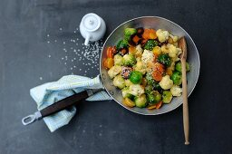 Stir-fried vegetables with Brussels sprouts and sesame seeds