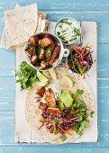 Fish tortilla with salad