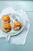 Tomato gougeres filled with ricotta cream and ham