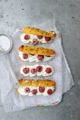 Eclairs with raspberries