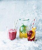 A raspberry smoothie, elderflower lemonade and a red grape drink