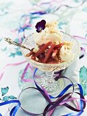 Vanilla ice cream with rhubarb sauce and violets