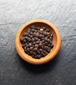 A bowl of black peppercorns