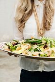 A colourful salad with green asparagus and prawns
