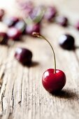 Cherries on a rustic wooden table
