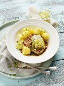 Tuna fish steaks in a caper sauce with salted potatoes