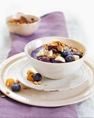 Blueberry yoghurt with cereals and almonds