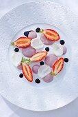 Hibiscus cream with strawberries, hibiscus juice and rose petals