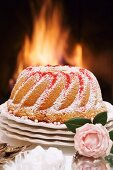 A Bundt cake in front of an open fire