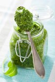 Rocket pesto in a jar and on a spoon