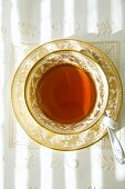 Tea in gold-rimmed cup