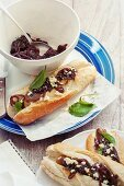 A mini baguette with red wine and onion confit and feta cheese