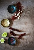 Dried chilli peppers, limes and corn kernels
