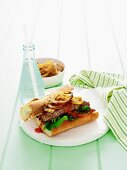 Rump steak, onions and tomato relish on baguette bread