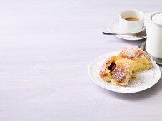 Praline Buchteln (baked, sweet yeast dumplings) with coffee