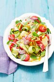 Courgette salad with cherry tomatoes, red onions, basil and parsley