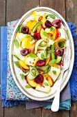 Courgette salad with nectarines, cherries and chilies