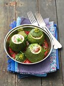 Round courgettes with minced meat filling in tomato sauce