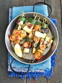 Salmon skewers with courgettes and prawns