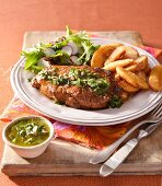 Grilled steaks with chimichurry sauce