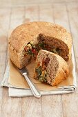 Wholemeal bread filled with spinach, feta cheese and dried tomatoes