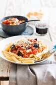 Penne rigate with a tomato and aubergine sauce and bacon