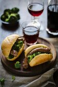 Italian sausages with broccoli in bread rolls