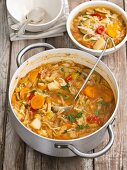 Minestrone with white cabbage, courgettes, tomatoes, potatoes, carrots and peppers