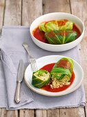 Cabbage parcels filled with bulgur and mushrooms in tomato sauce