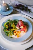 Roast beef rolls with a green salad and croutons