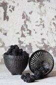 Fresh blackberries in black baskets