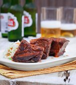 Cola-marinated beef with coleslaw and beer