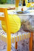 Paper lantern on yellow and grey chair