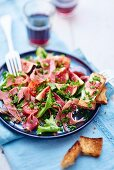 Mixed leaf salad with ham and figs