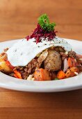 Fried potatoes with chorizo, onions, root vegetables and a fried egg