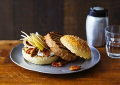 A Canada burger with apple, fennel, pecan nuts and maple syrup