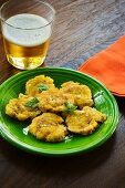 Tostones (deep-fried plantains) from Cuba with a beer