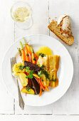 Sheatfish with beetroot, yellow beets, carrots, herbs, oranges and pesto