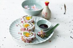 Uramaki sushi with colourful bean sprouts