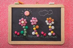 Bonbon flowers on a chalkboard