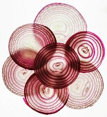Black lit slices of red onion