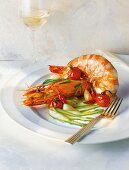 King prawns on a bed of green asparagus with melted cherry tomatoes