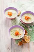 Cream of asparagus soup with smoked salmon and grilled bread